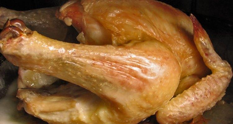 Chicken should reach a centre temperature of 73.9 degrees C.