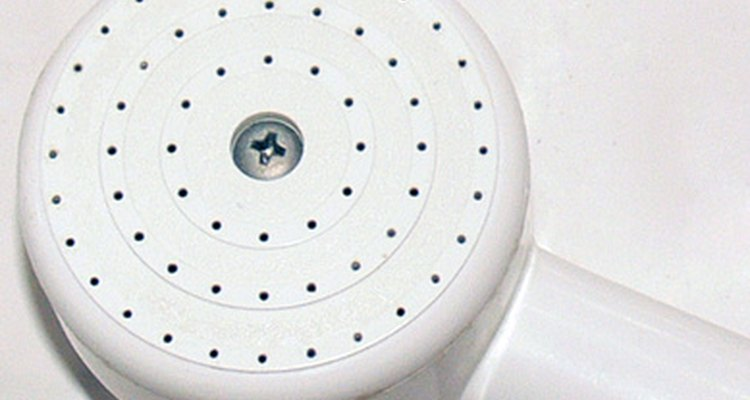 Get rid of water deposits restricting the flow of your showerhead.