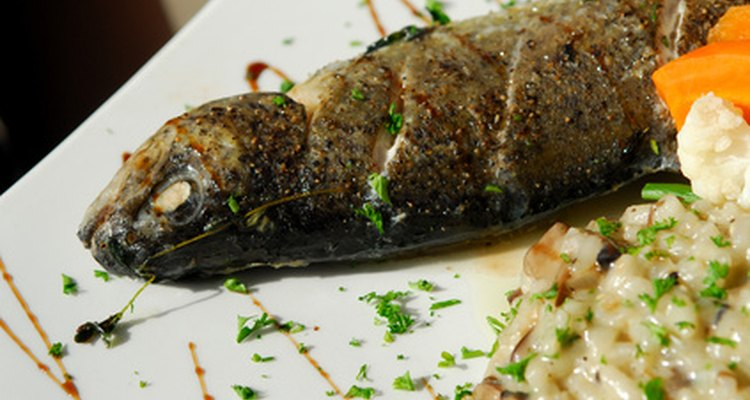 A dressed fish is served with its head intact.
