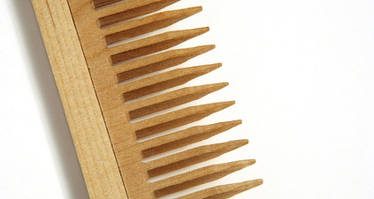 Comb hair with a wide tooth comb.