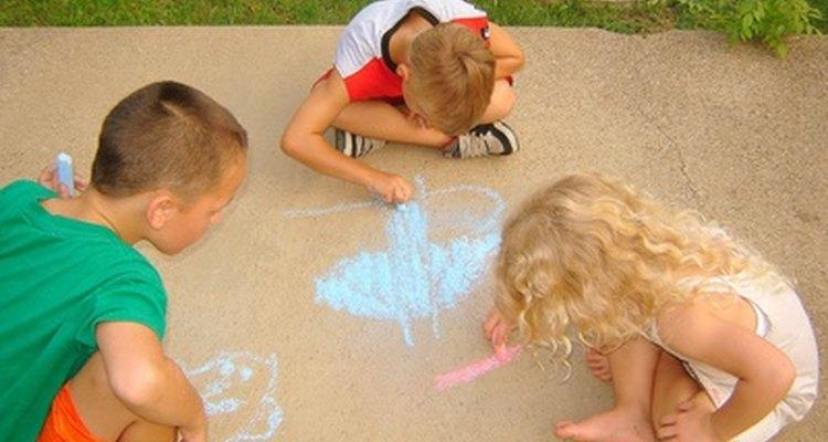 Children share materials during associative play.