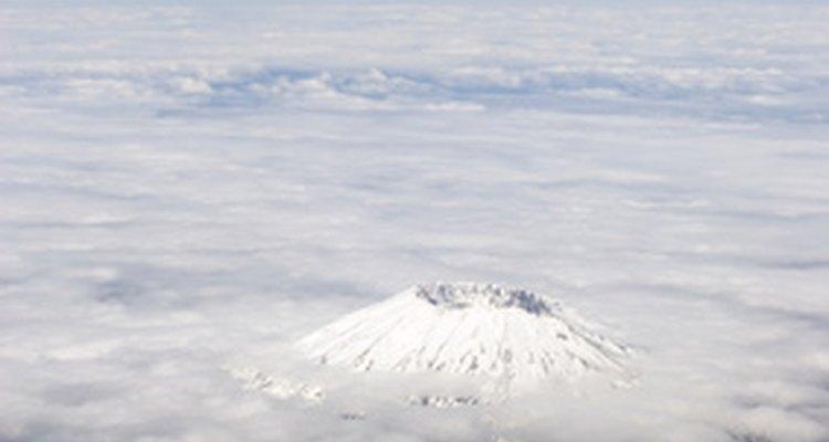 Volcano top peeking through the clouds