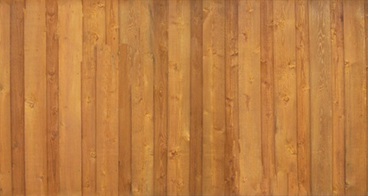 Composite wood fencing looks similar to standard fence but may darken more with age.