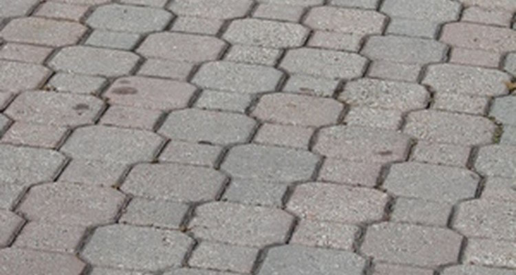 Prepare to remove wax by placing a towel on the pavers.