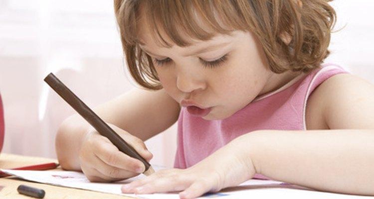 A preschooler writing