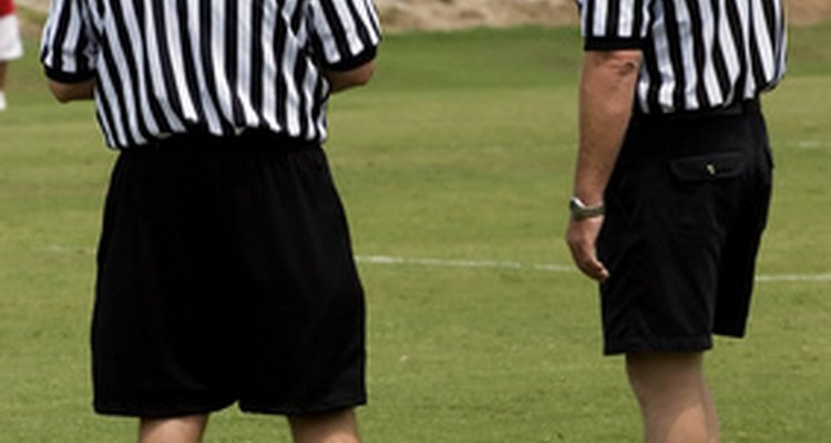Referees monitor game play, including adherence to safety rules.