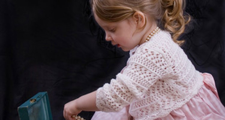 Playing dress-up gives preschoolers a chance to learn what it is like to be an adult.
