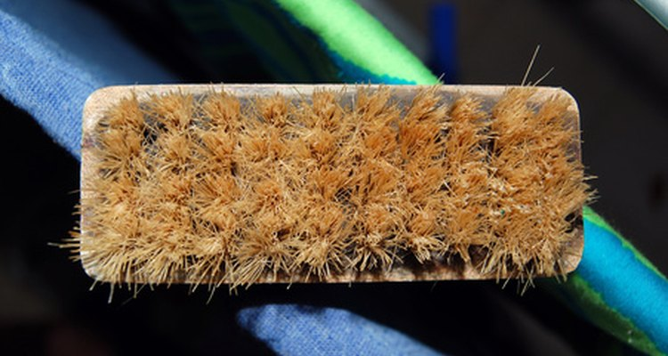 A scrub brush allows you to get into the woven areas of rattan furniture.