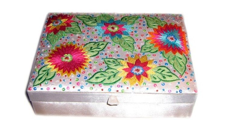 A fabric-covered wooden box can hold your knitting supplies or personal treasures.