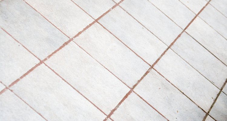 Remove urine stains from grout to keep the grout in good condition.
