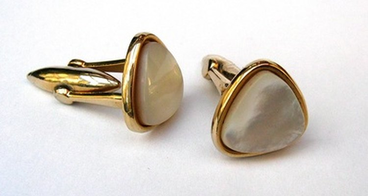 Gold cuff links are appropriate favours for guests.