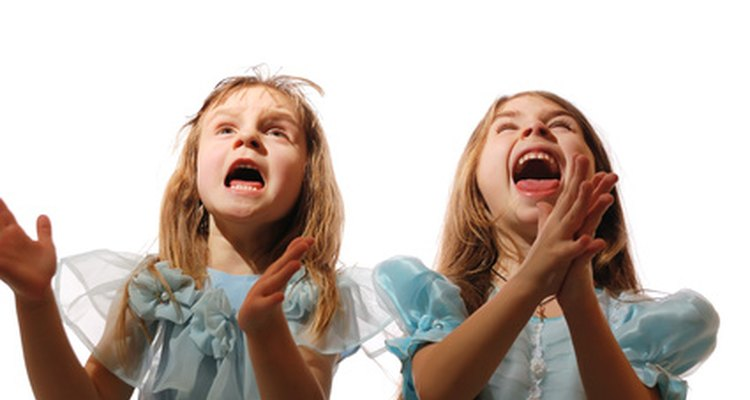 Having children clap to the beat of the music helps them experience music with their bodies.