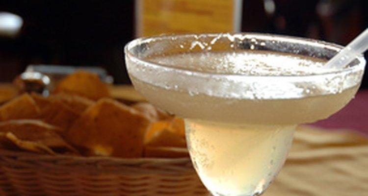 A barmaid serves drinks at a restaurant, bar, pub or nightclub.