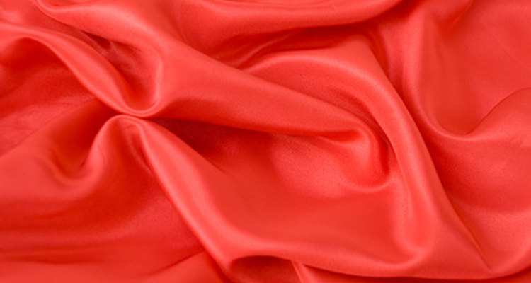 Wash water stains off satin fabric.