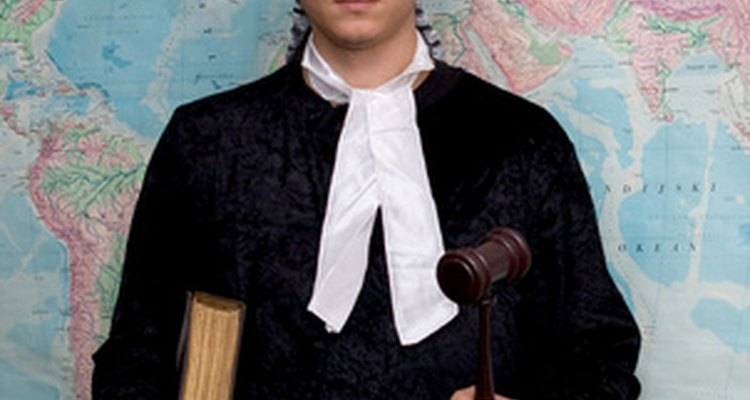 Barristers wear wigs while defending clients during court proceedings.