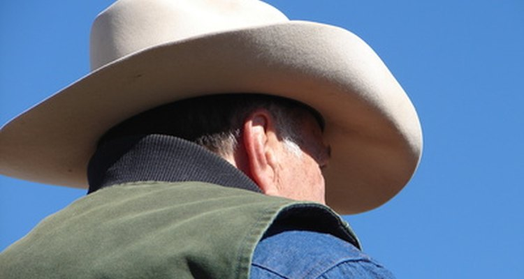 A hat makes it easy to identify a cowboy.