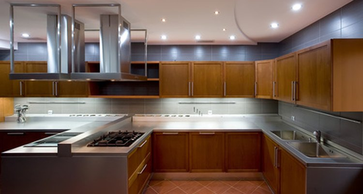 Ovens, sinks and refrigerators are the basics found in a kitchen.