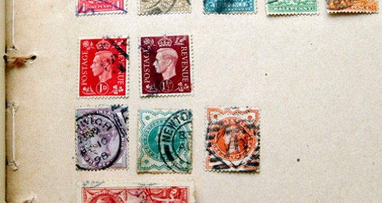 These stamps have been mounted using hinges--small strips of gummed paper.
