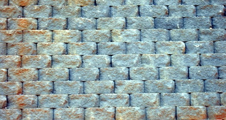 Stacked retaining-wall block does not require mortar.
