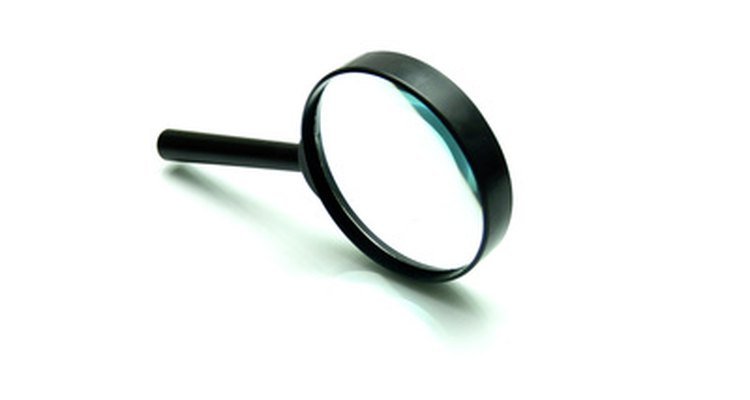 The devil is in the details--a magnifying glass can help you spot the cleverest of fakes.