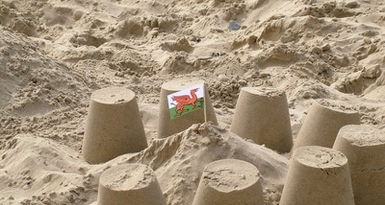 Use old flower pots for sand play.