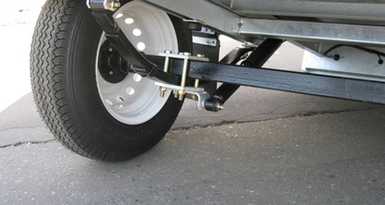 Spring mechanisms provide the trailer with its suspension assembly.