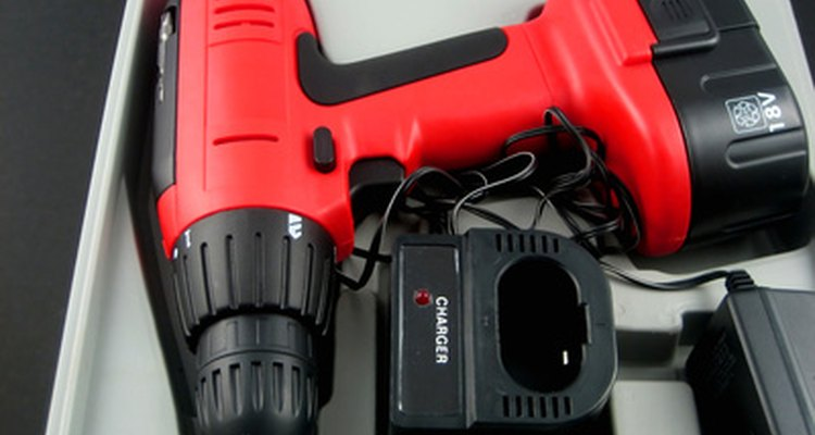 Use a cordless drill to drive treated deck screws to attach the bracket.