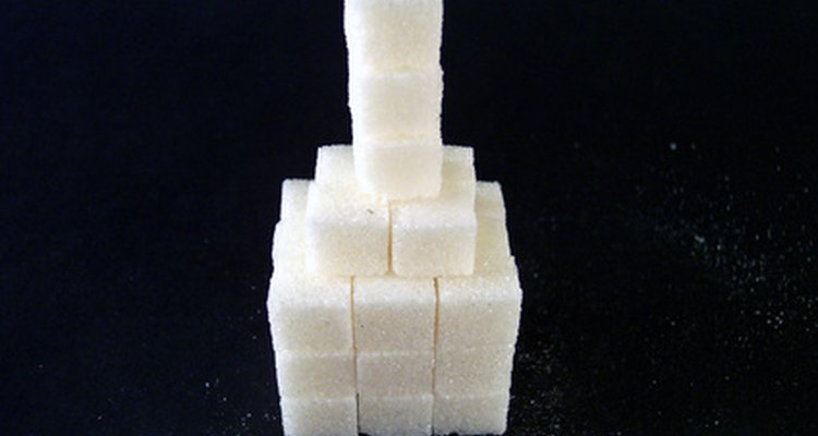 Make sugar cubes stick together with glue or icing.