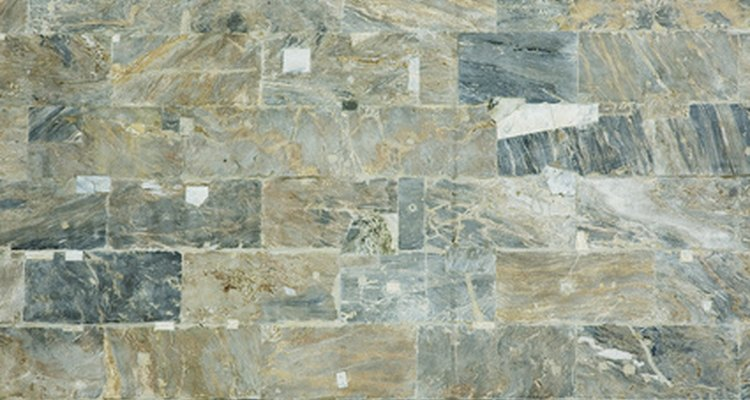 Abrade the marble tile to promote adhesion.