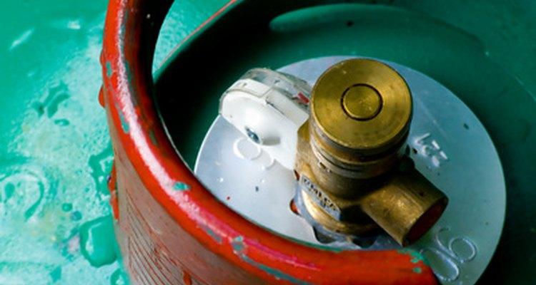 Ajuste a pressão com o regulador de gás