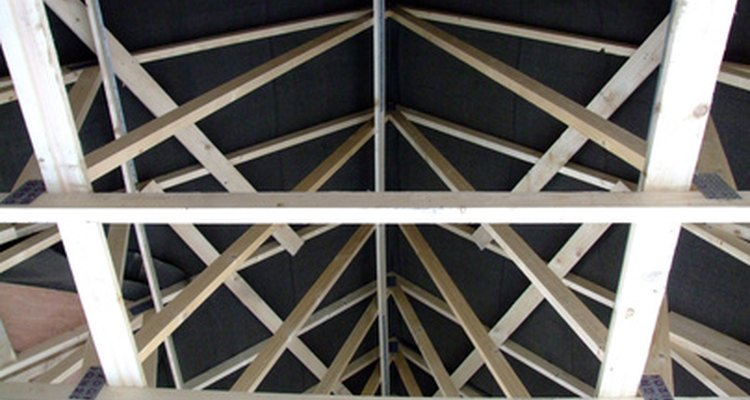 Roof trusses help spread the weight of the roof to the exterior walls.