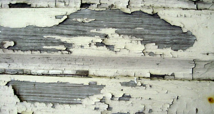 Remove peeling paint by sanding, scraping or scouring wood.