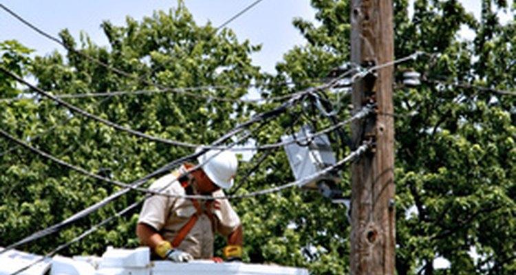 Linemen work on power lines.