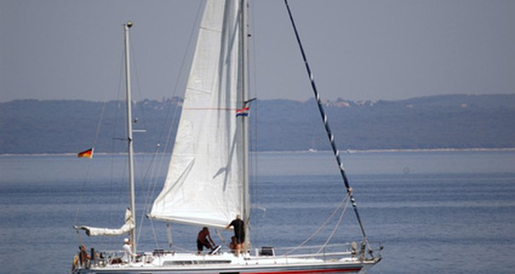 Sail boat rigging has a pulley system to bring the sails up and down.