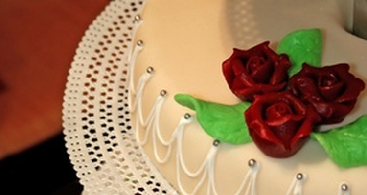 Royal icing swags add elegance to a wedding cake.