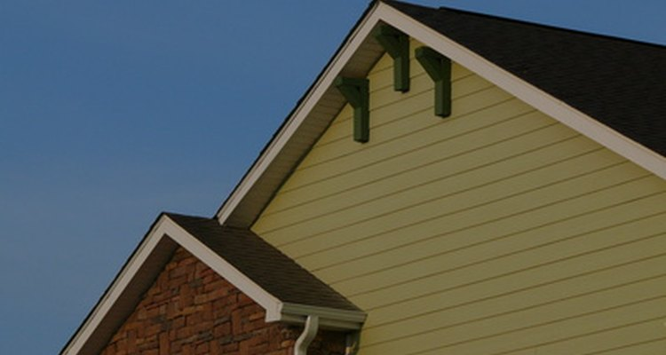 The overhang on the gable end of a house protects the house from water damage.