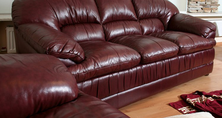 Revitalise an old leather sofa by replacing the cover.