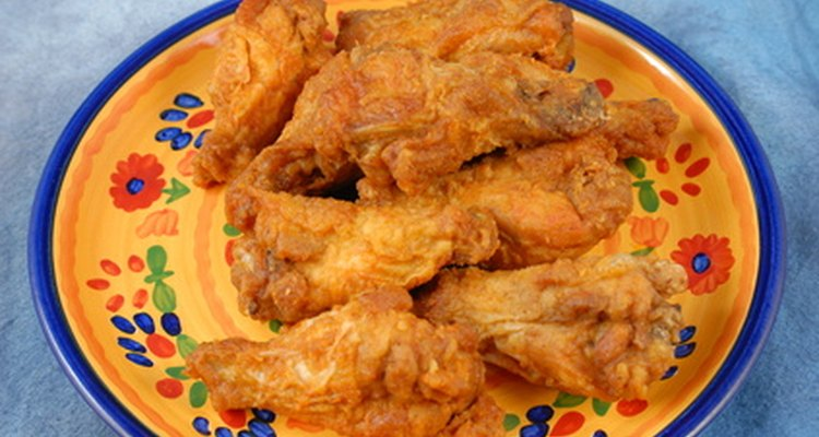 Chicken wings, served with sauces and dips, are an ideal teen food.