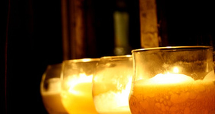 Candles light up the night on a patio.