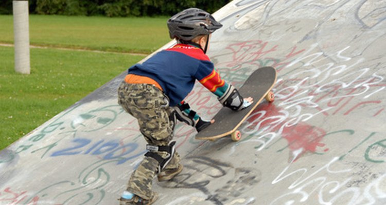 Young skateboarder making his way up the ramp
