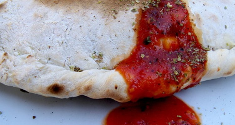 Reheat your calzone in foil to keep the crust crisp.