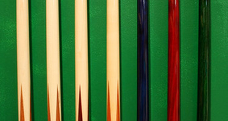Remove dents and dings from cue sticks with a clothing iron.