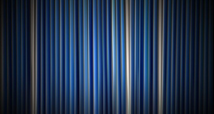 Straight vinyl vertical blinds are easier to adjust and close.