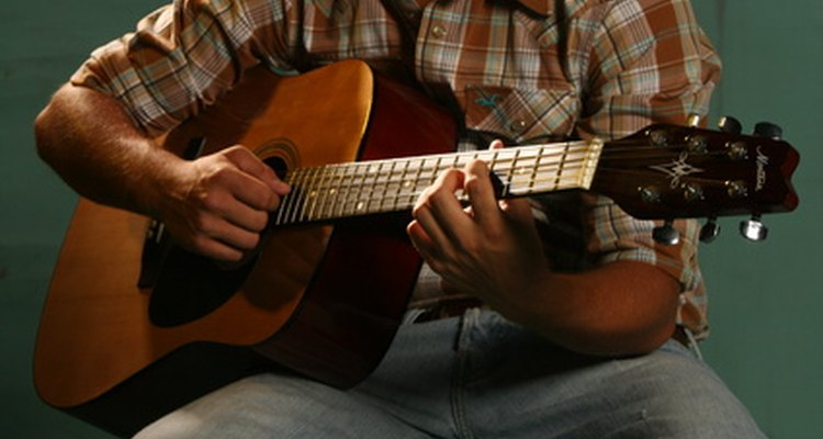 A hurdy gurdy is an early version of an acoustic guitar, but with a wheel and a keyboard.