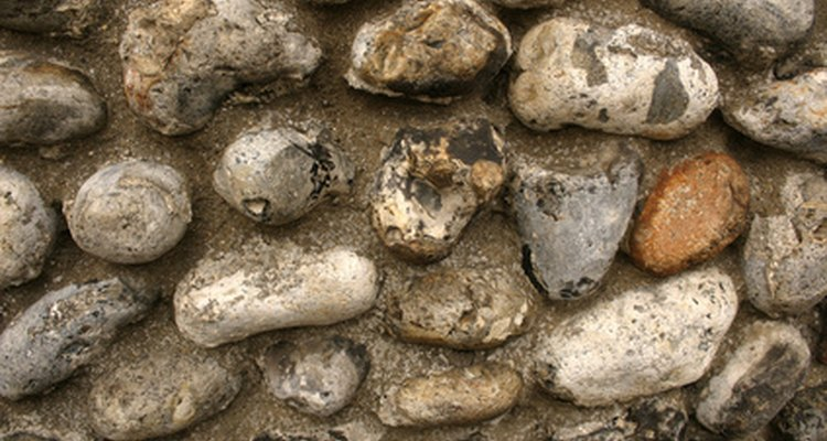 Stone cladding sometimes consists of stones glued to the side of a wall.