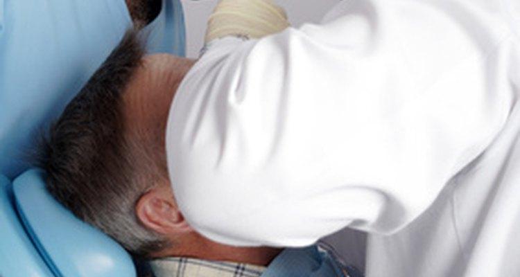 A dental nurse tends to patients' comfort during procedures.
