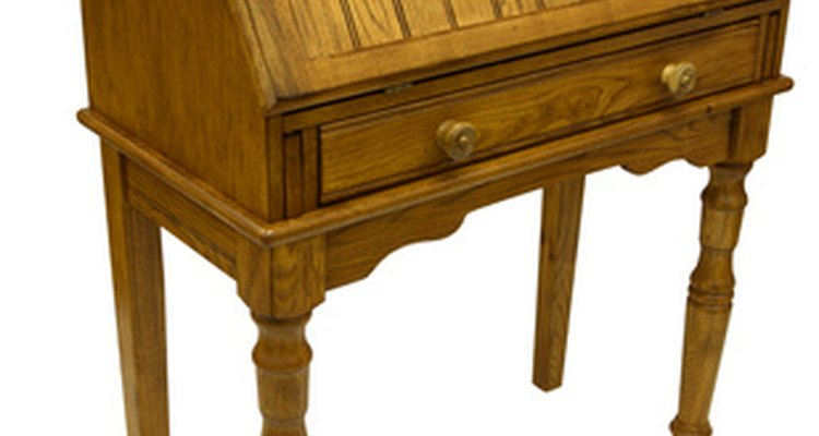 Vintage writing desks typically have a leather top or inlay.