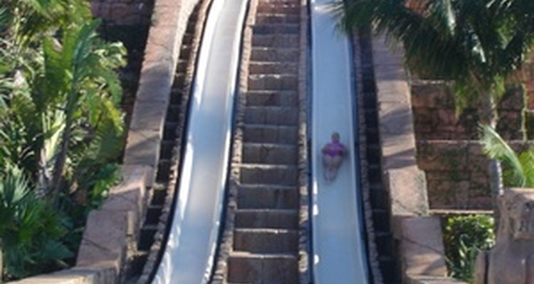 Water slides send riders into a pool.