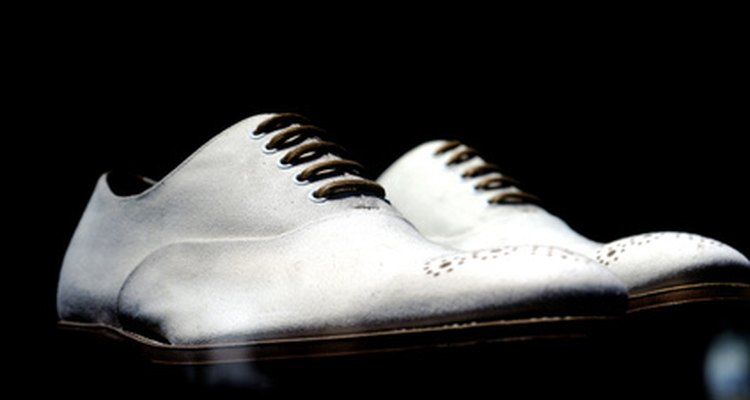 You can remove black marks from white leather shoes using common household products.