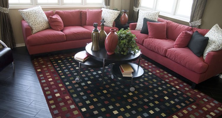 This room's cranberry-coloured furnishings balance well with its dark wood floor.